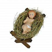 Dzieciątko Jezus na sianku w drewnianym żłóbku